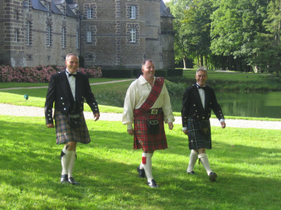Three men in kilts (Bob is in the center)