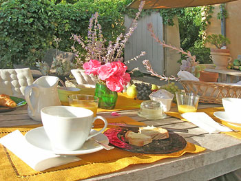 Breakfast on the terrace.   Copyright Cold Spring Press.  All rights reserved.